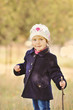 toddler girl in autumn time