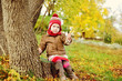 toddler girl in autumn park