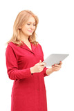 Mature smiling woman looking at tablet