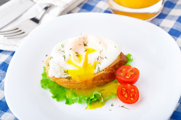 Poached egg with dill on bread