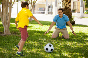 Playing soccer with my dad