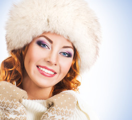 Beautiful woman in traditional winter clothes