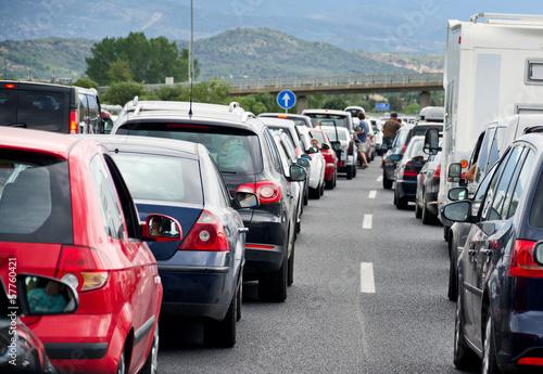 canvas print picture Autobahnstau Rückreiseverkehr Autos Stau