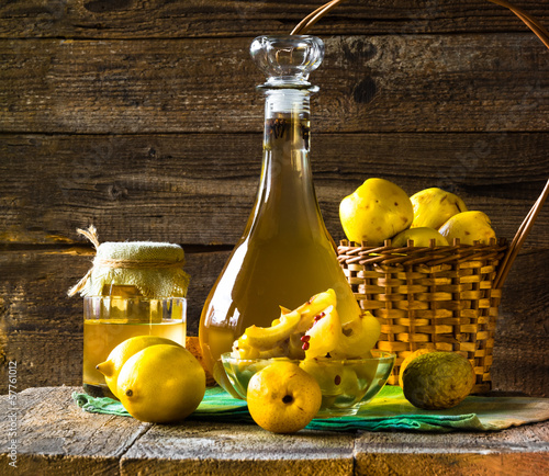 alcohol quince liqueur sliced fruit prepare wooden setting - 57761012