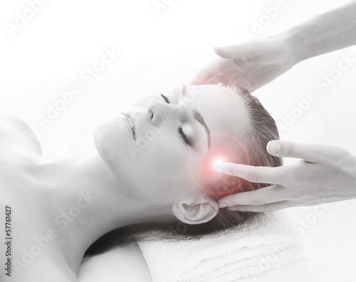 An attractive woman getting massaging treatment