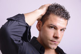 Attractive man formal portrait.Accommodate hair. poster