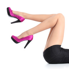 Beautiful woman legs with fuchsia high heels
