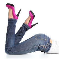Beautiful woman legs with jeans and high heels