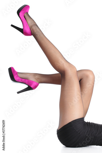Beautiful woman legs with fuchsia high heels and black tights