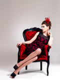 Woman with fashion hairstyle and red armchair
