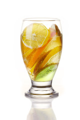 Slices of tropical fruits in glass of water