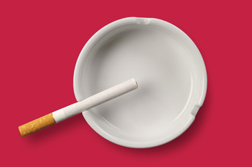 White ashtray and cigarette