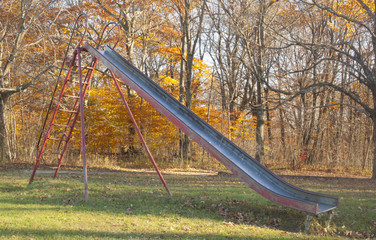 A metal slide outside in a playground