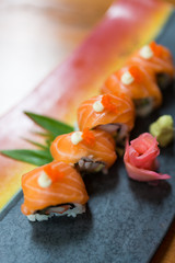 Salmon maki roll sliced on dish