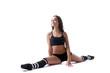 Attractive smiling model posing sitting on split