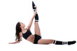 Flexible skinny woman doing stretching in studio