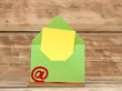 E-mail symbol and colorful envelopes on old wooden background. c