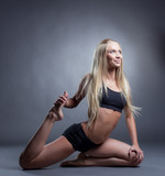 Cute long-haired blonde doing stretching