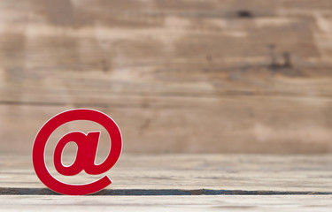 E-mail symbol on old wooden background