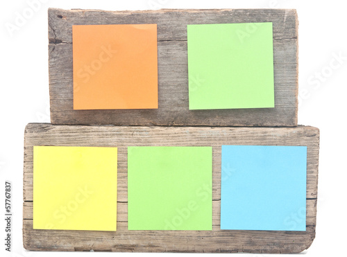 colorful reminder notes attached on a old wooden signboard