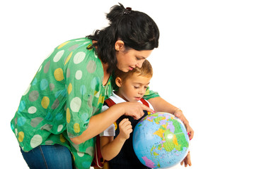 Mother showing to son on world globe