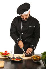 Chef male cutting eggplant