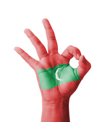 Hand making Ok sign, Maldives flag painted