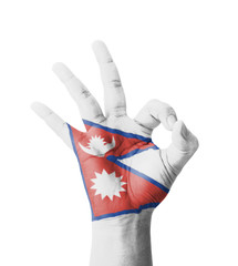 Hand making Ok sign, Nepal flag painted