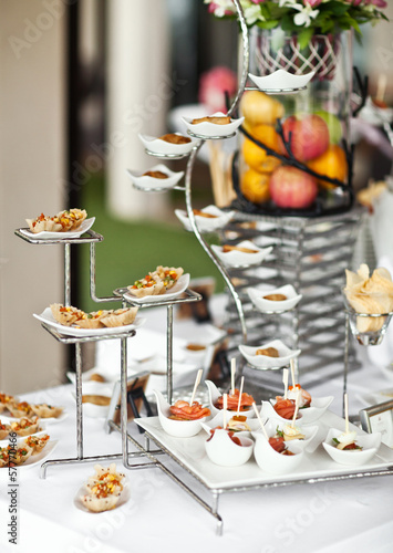 Luxury food and drinks on wedding table. Different sort of canap - 57770466