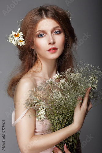 Sentiment. Portrait of Redhair Nostalgic Woman with Herbs
