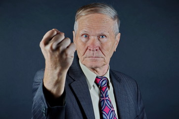 Businessman with fist ready to fight