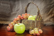Grapes and green apple with old basket