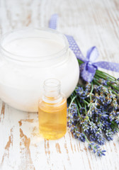 container with cream, massage oil  and lavender