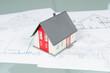 Modellhaus auf Bauplänen