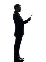 business man smiling   digital tablet  silhouette