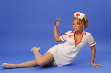 Sexual woman in nurse suit with stethoscope