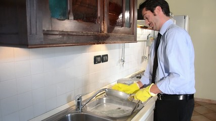 businessman washing dishes