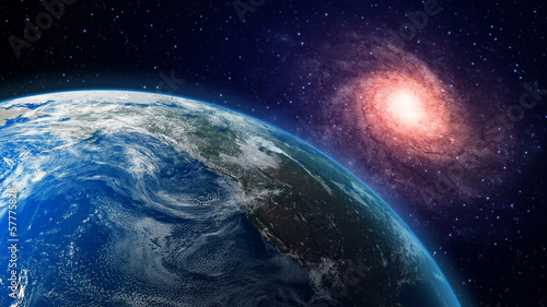 Fototapeta Earth and a spiral galaxy in the background