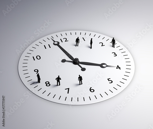 Tiny people standing around a clock