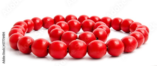 Red wooden beads and bracelet isolated on a white