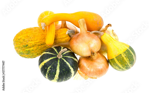 Gourds and onions on a white background
