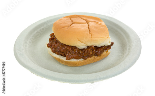 Bun pork and barbecue sauce sandwich on paper plate