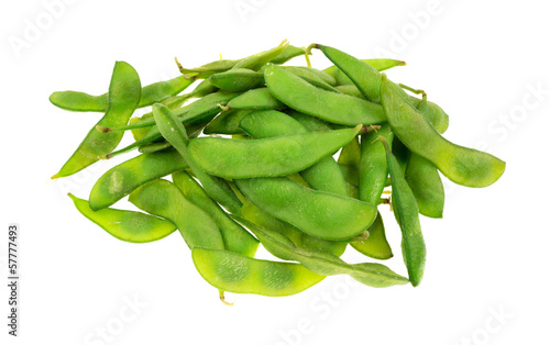 Cooked edamame pods on a white background