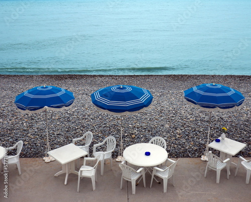 Lounge chairs, tables and parasol