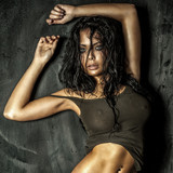 Portrait of beautiful brunette girl with wet hair.