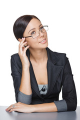 Smiling businesswoman sitting at table looking up