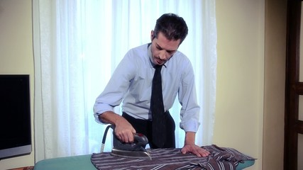 businessman ironing at home