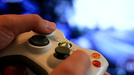 Man playing video game with a joystick