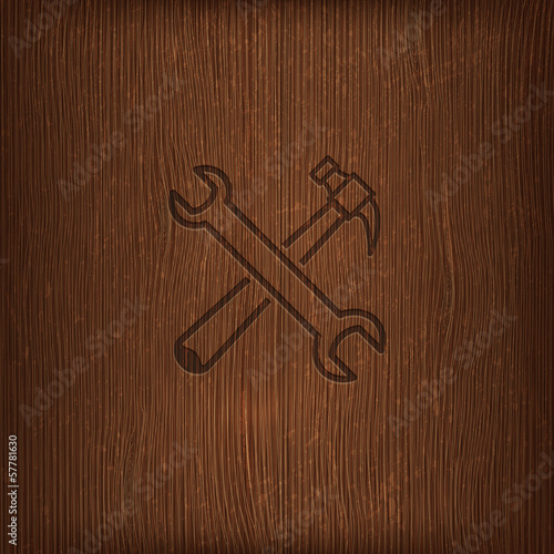 illustration with a hammer and a wrench icon on wood background