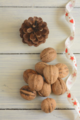 Walnuts, cone and ribbon.Christmas background.